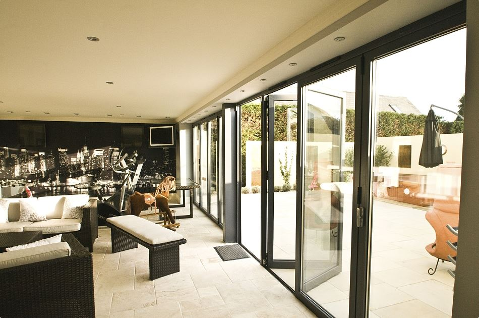 Fold and Slide Doors   If an union of exterior and interior is your goal, then Mavrik's fold and slide doors are the best solution.  Contact us  for more information on this special product.