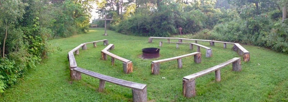 Our campfire area can seat about 75 people around a centrally located fire ring. It's very near Round Lake, so evening sunsets will be able to set the mood for your group here. We have also recently updated our benches.