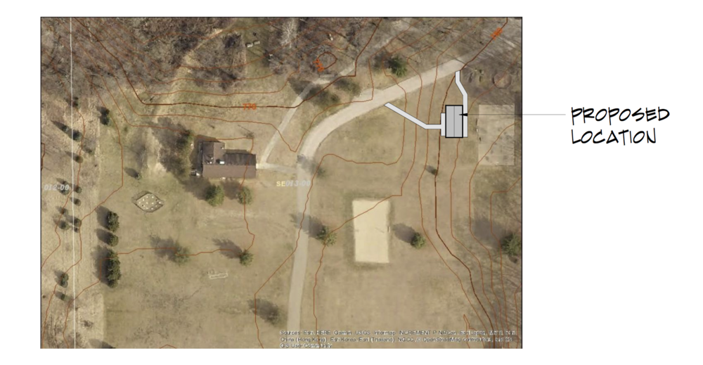 Here's an overhead view of the proposed location. You can see the staff housing building is near the basketball court, program shed, and gaga ball, in the upper right-hand corner.