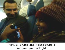 Rev El Shafie and Neeha on the flight to safety