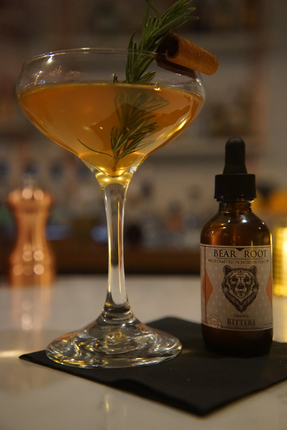 MountainMan-Hattan - Ingredients2 oz Rye whiskey (or sub Bourbon)½ oz Sweet Vermouth½ oz Dry Vermouth1 Tsp Lemon Juice3 dashes of Bear Root Cherry BittersDouglas Fir sprig garnish (or sub orange peel)RecipePour liquid ingredients into a mixing glass with ice. Stir. Strain into a cocktail glass. Add garnish.*Traditional Manhattans are served up and chilled in a Martini Glass.*Enjoy by a campfire morning, noon or night.