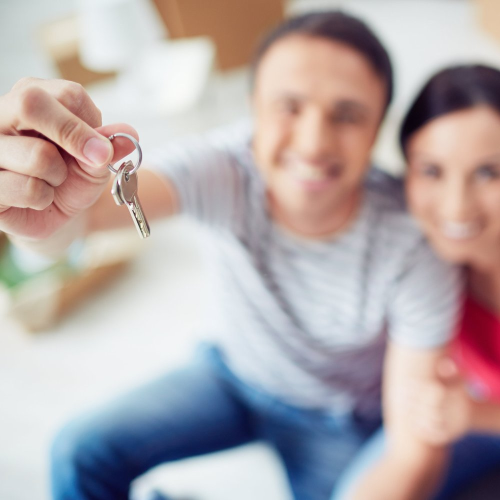 graphicstock-young-couple-showing-key-from-new-apartment_B7LprEUGVZ.jpg