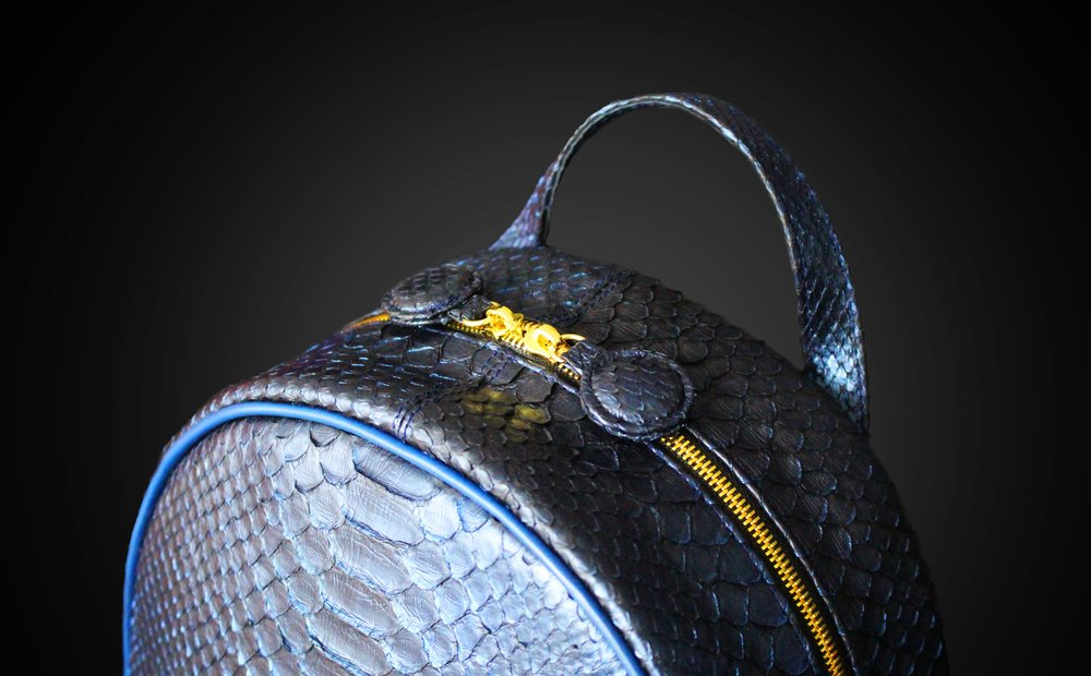 Metallic blue python backpack