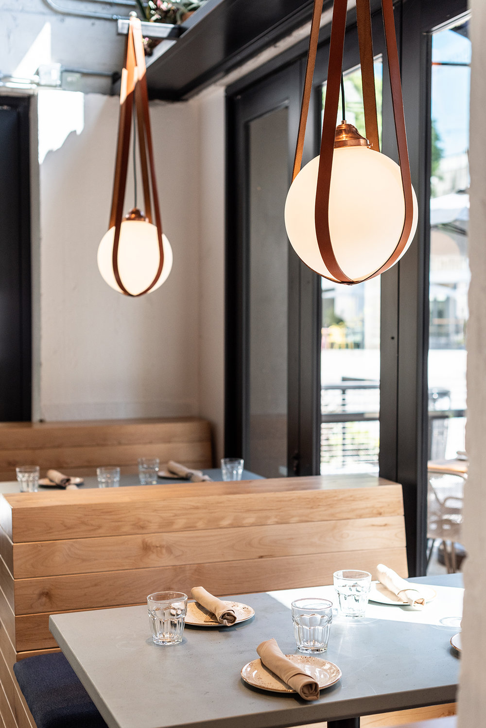 Custom Paul Paige pendants @ Rappahannock Oyster Bar  / restaurant design by Studio Unltd