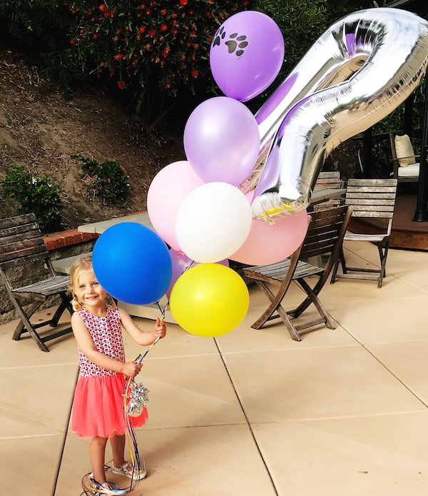 Rosie on her third birthday,when wish lists come true!