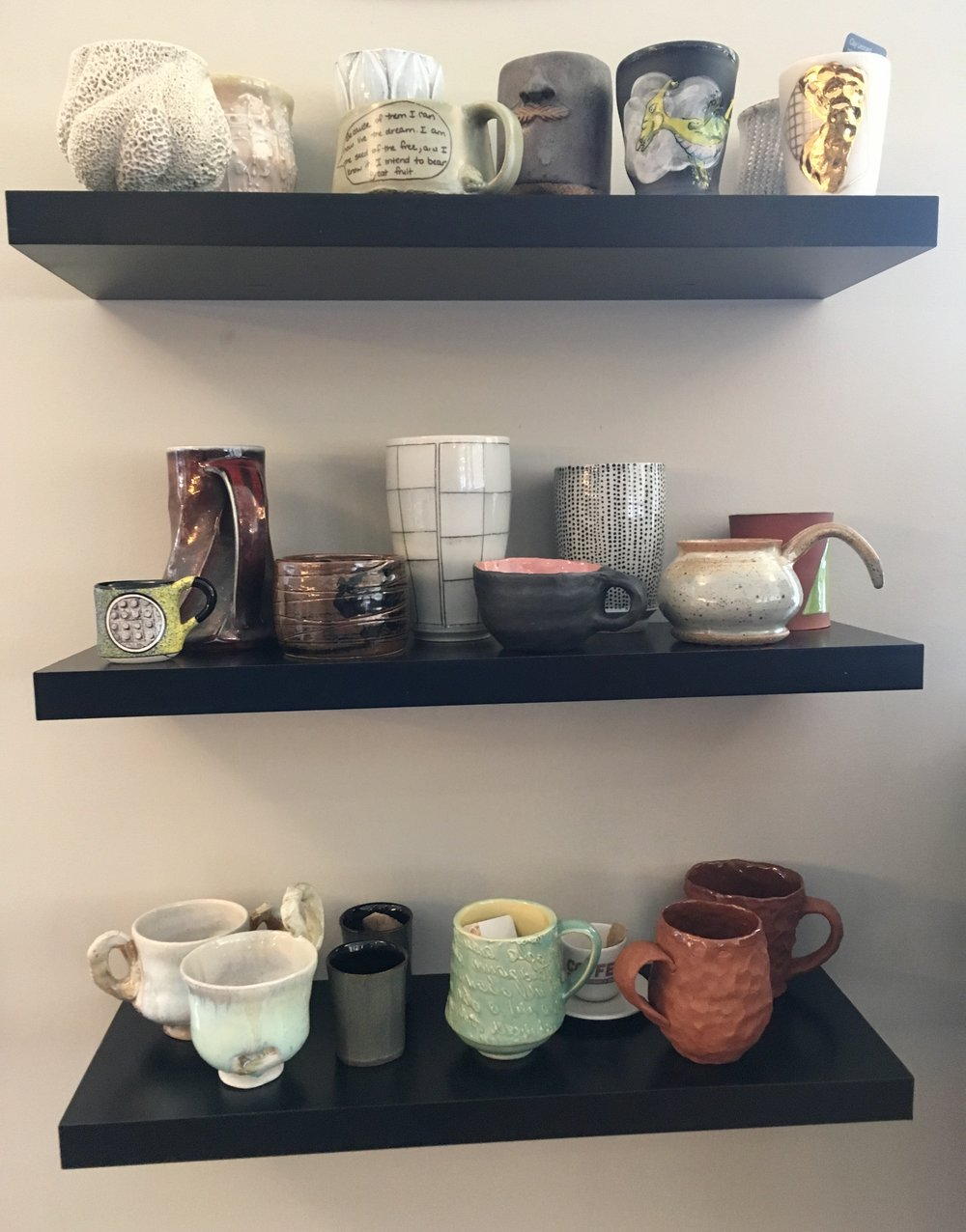 Some of the mugs on display at Everyday Cafe during Cups of Conversation: 50 States.