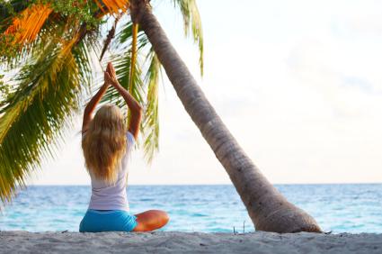 yoga woman under palm