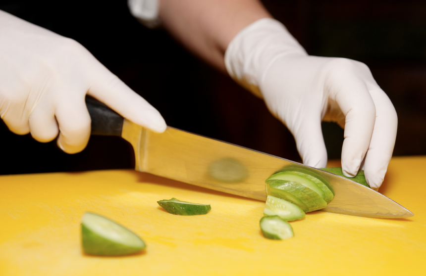 Chef is cutting cucumber
