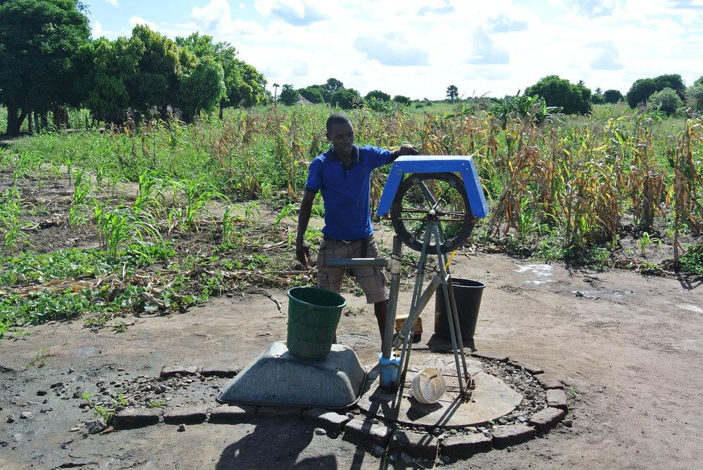 Armando pumping water.JPG