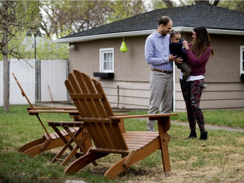 Scott Wright, Alexia Wright, and their son Luca Wright, 2, in the backyard of their Grovenor home.DAVID BLOOM /POSTMEDIA