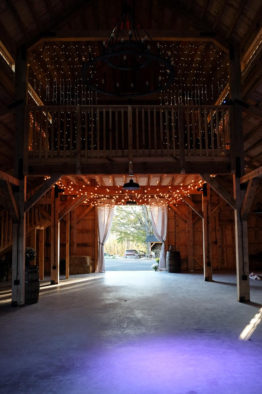 The Inside Of A Barn Set Up For Wedding At Windsong Konnarock