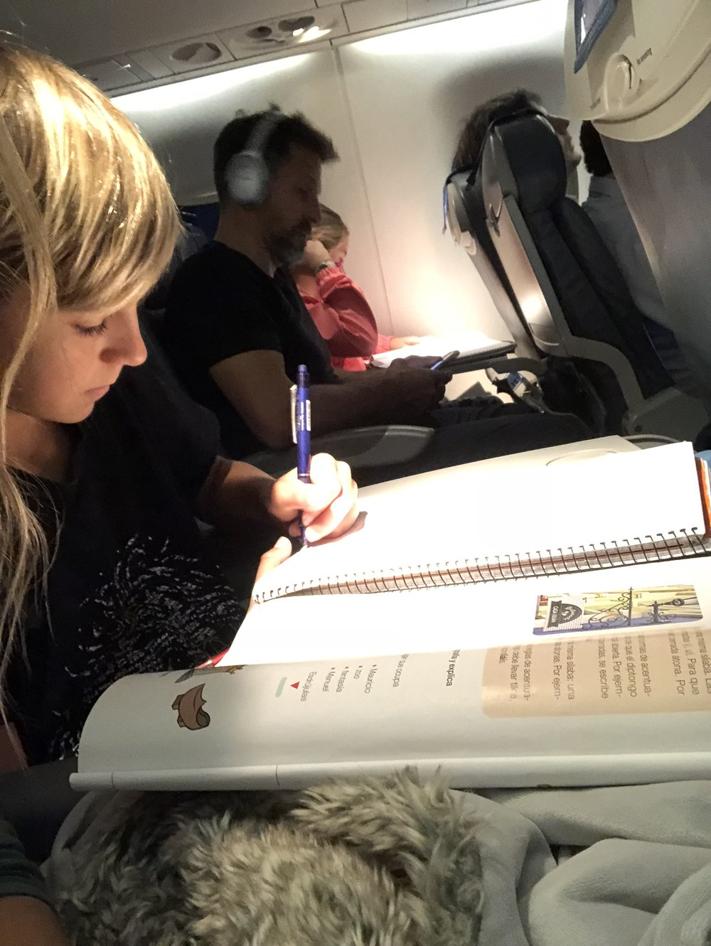 Working on their homework - On the airplane.