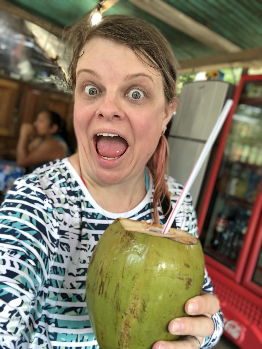 crazy for coconuts; fresh coconut and vodka was well-earned after the death-march to the top of the falls in the humidity; that's a UV swim shirt so I can avoid sunburns (highly recommended in Mexico)