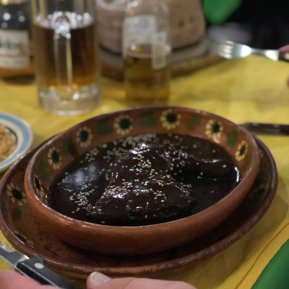 chicken in mole sauce; that's not just a brown gravy, it's a complex sauce with so many flavors, and no two moles are the same