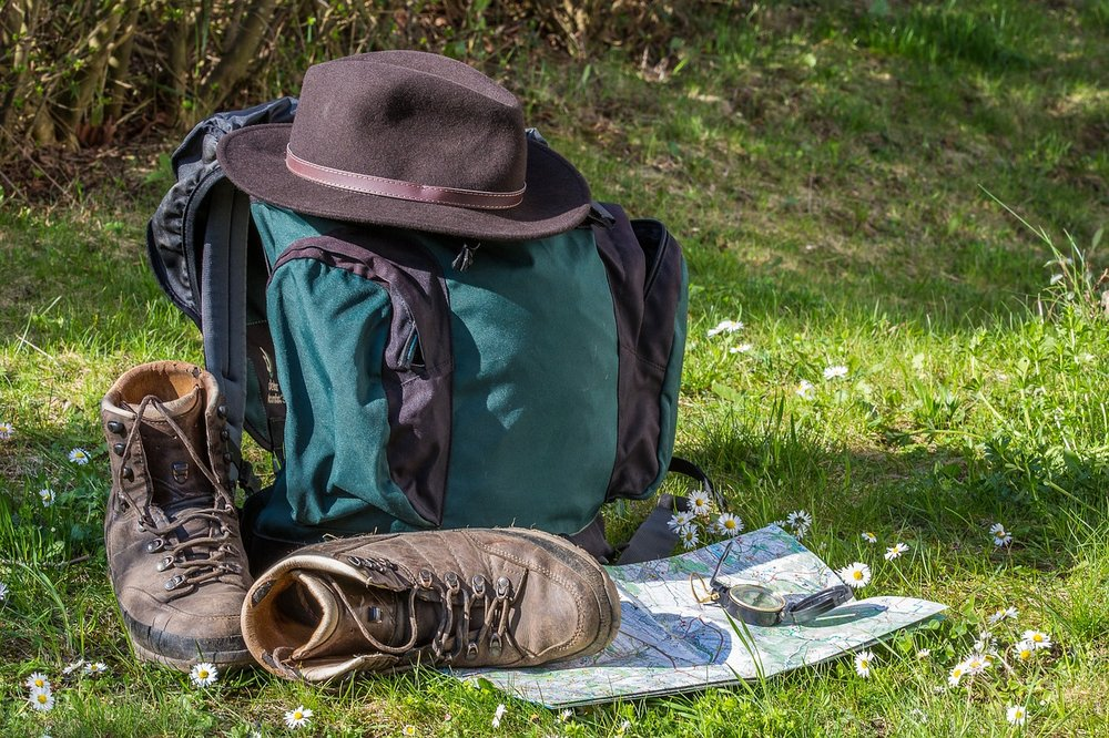 Hiking boots and gear in a field