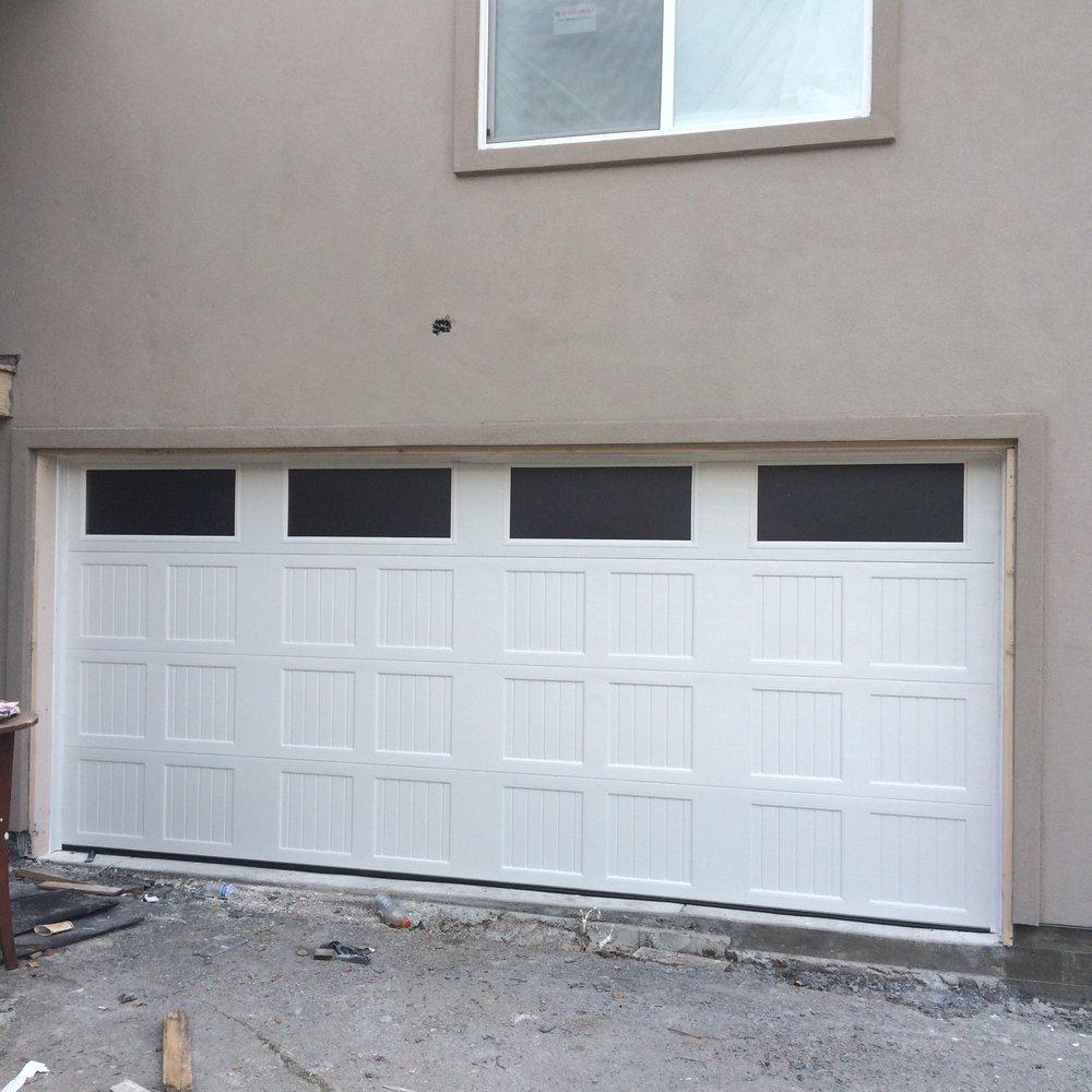 all bay garage doors - carriage house garage door - kevin chervatin - 9.jpg