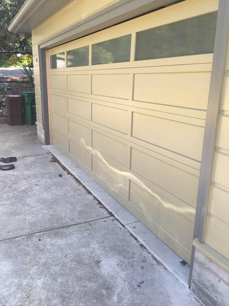 13 All Bay Garage Doors - Solid Wood Garage Doors - Kevin Chervatin - 1.jpg