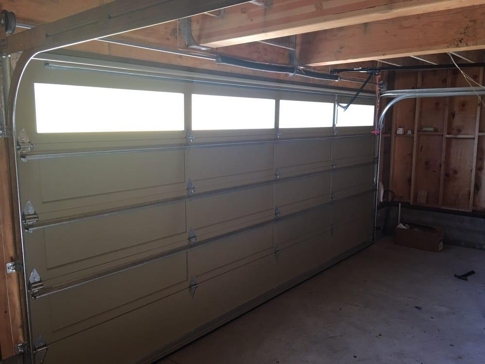 12 All Bay Garage Doors - Solid Wood Garage Doors - Kevin Chervatin - 1.jpg