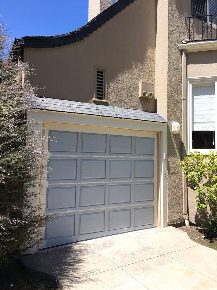 4 All Bay Garage Doors - Solid Wood Garage Doors - Kevin Chervatin - 1.jpg