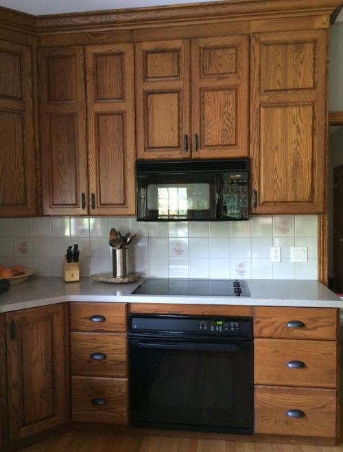 oak kitchen cabinets with white subway tile