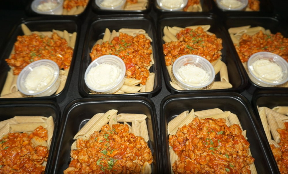 Turkey Bolognese  Whole Wheat Penne Pasta in our homemade Bolognese sauce. Topped with Parmesan and basil.