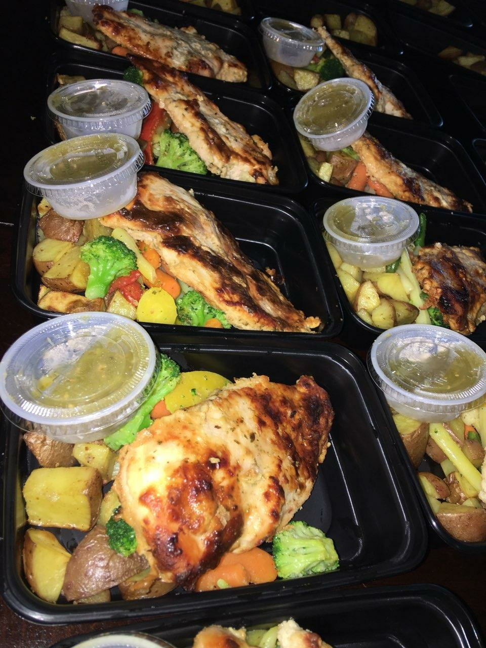 Texas' Baked Chicken  Delicious baked chicken breast served with roasted seasoned potato and veggie mix.