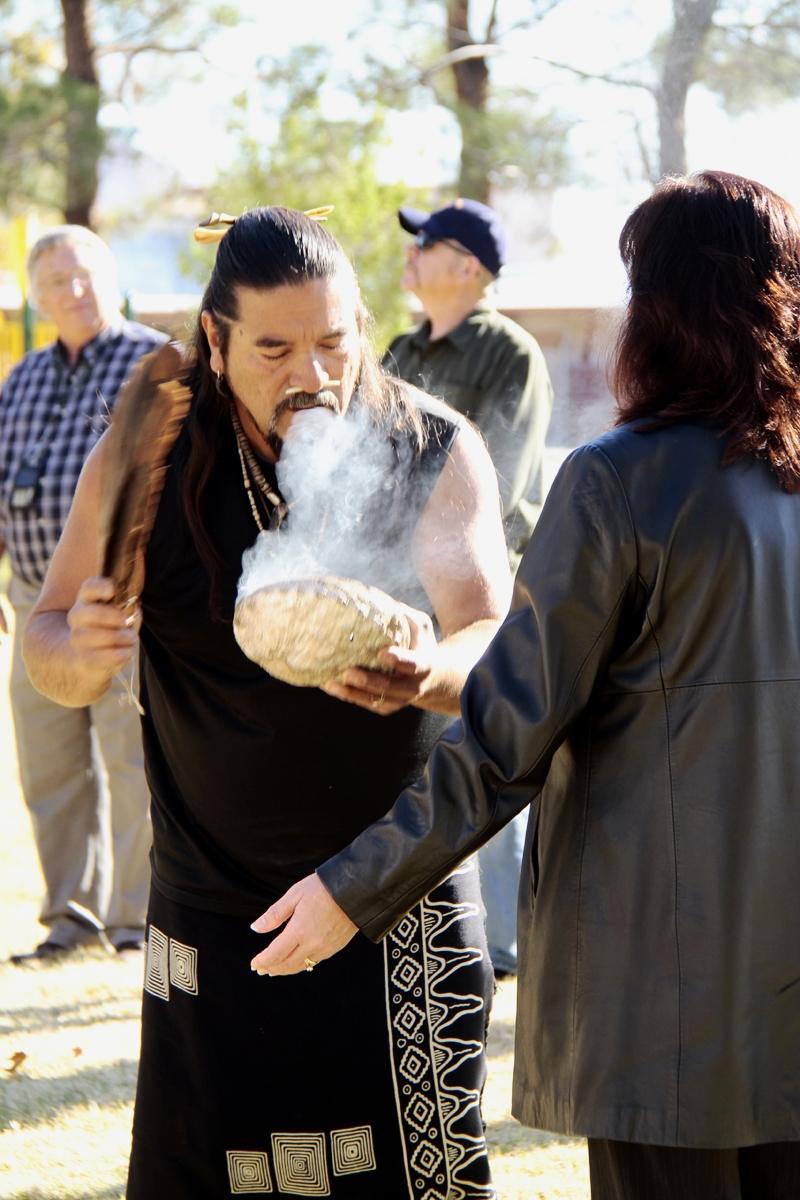 Mati Waiya, Chumash ceremonial elder and Dolphin Dancer uses sage smoke during a ceremony at the Native American Heritage event at China Lake.