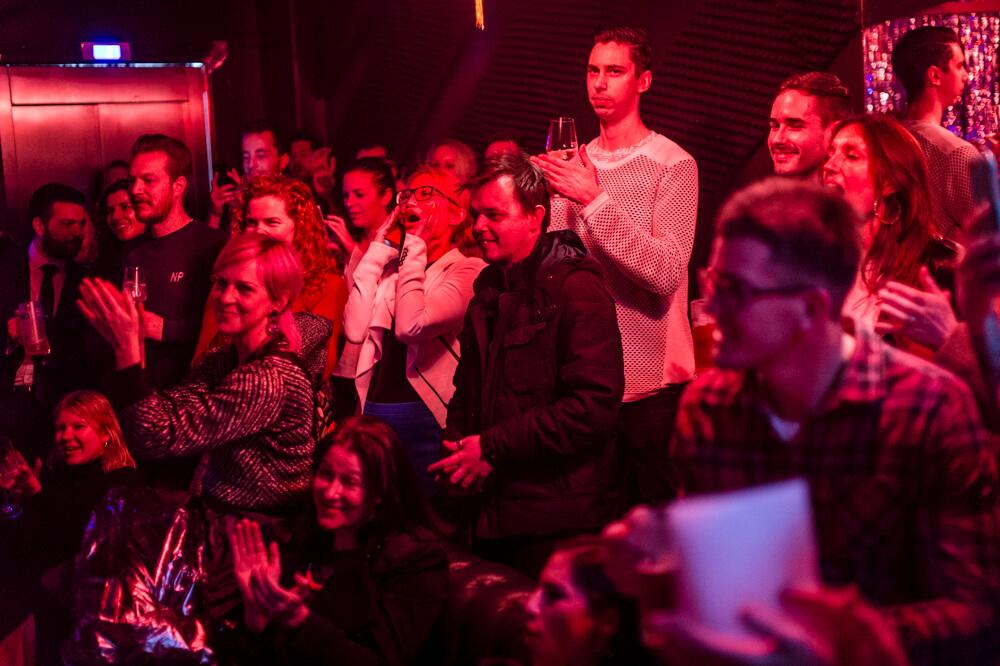 Crowd watching karaoke