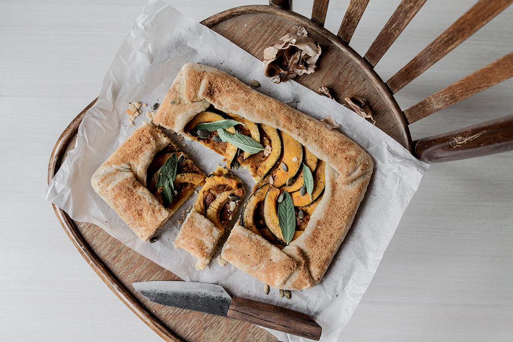 pumpkin tart with sage and pumpkin seeds