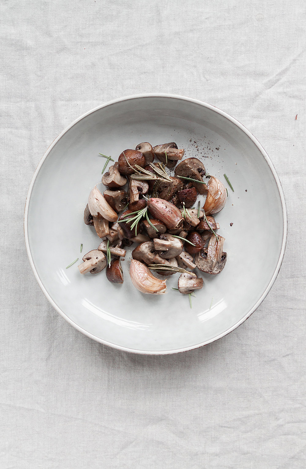 oven roasted chestnut mushrooms with pink garlic and rosemary