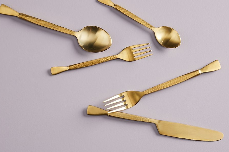 The shinny Hammered Golden Flatware by  Anthropologie .