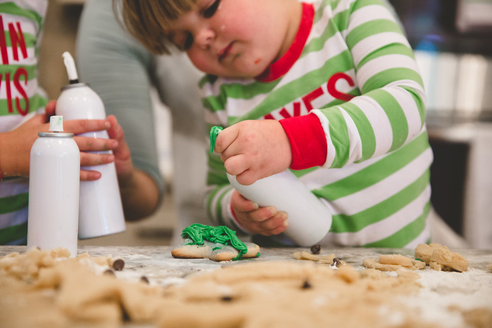 Cookie decorating during Christmas family portrait session