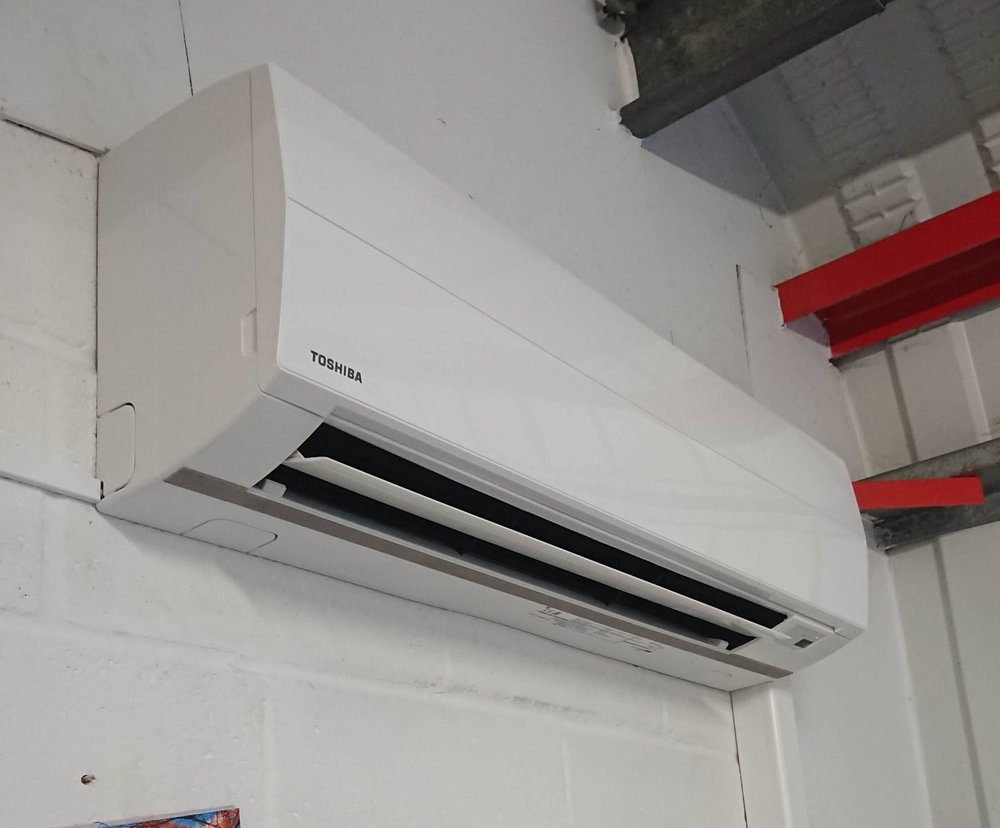 Twin split air conditioning for Mezz floor providing Heating & Cooling for an office - E-Teck - Alton