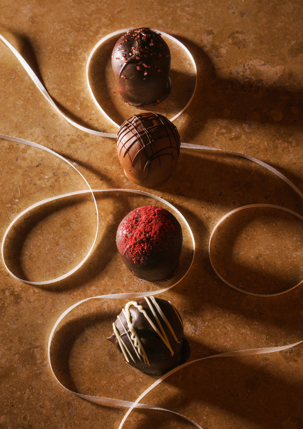 Chocolate truffles with a white ribbon