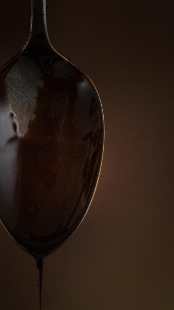 Chocolate sauce spoon drip