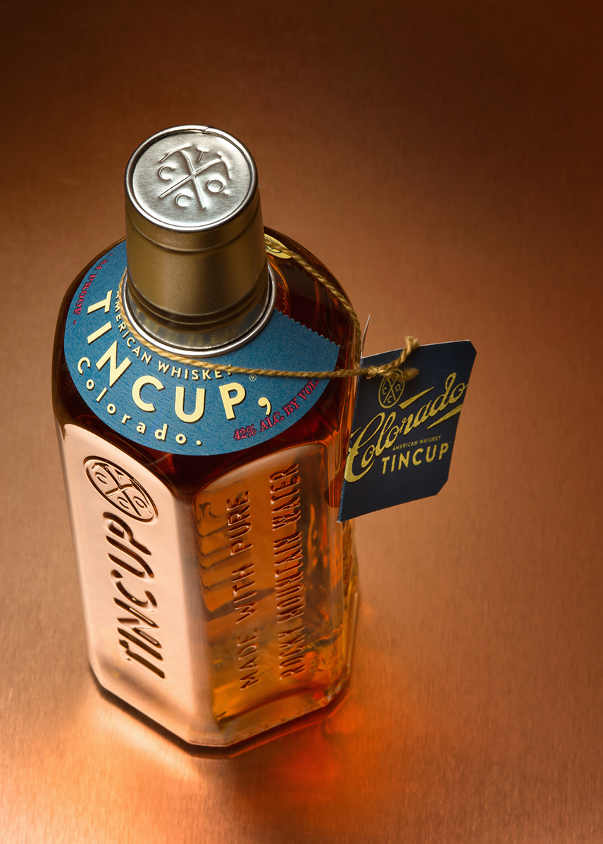 Tincup Whiskey photographed on copper sheet