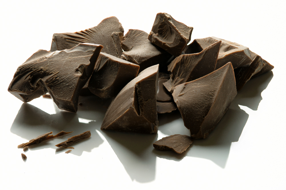Chunks of Callebaut milk chocolate block