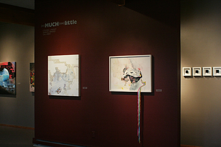 Foreground left, painting by Langley, foreground right, drawing with ribbons by Gala Bent; background left, two peeks of Langley paintings and background right four from Sharon Arnold's  1:1  series