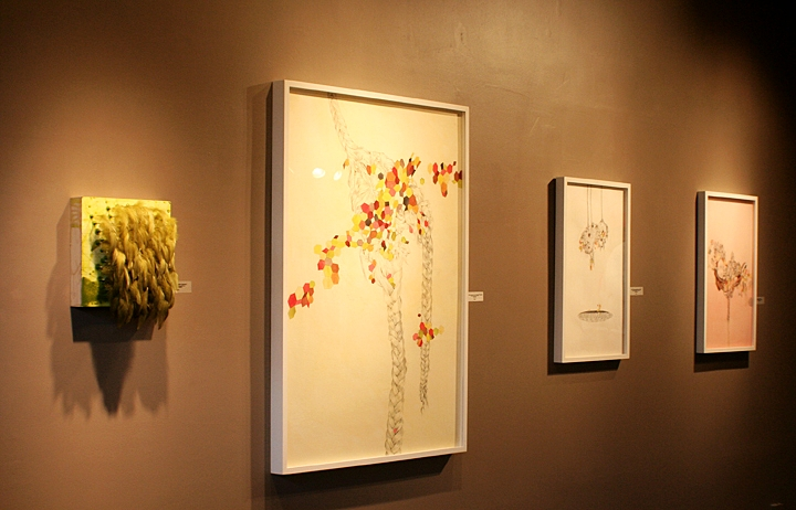 from left to right: one feathered Langley, three works by Gala Bent