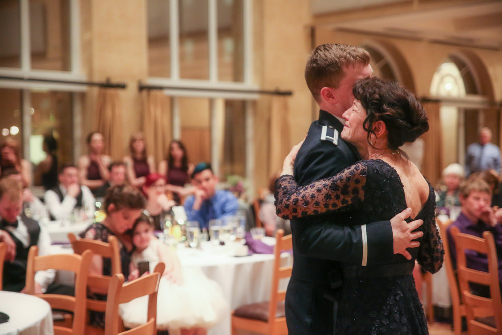 Mom and Son… - The emotion captured during the mom and son dance never disappoints!