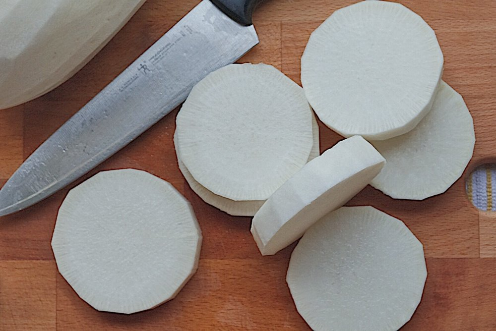 First slice mu into rounds. - To ensure safety, feel free to cut mu on a towel or paper towel.