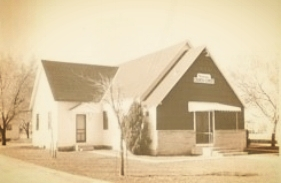 After meeting in a borrowed church building, a tent and a house, the first permanent building was constructed in 1945.