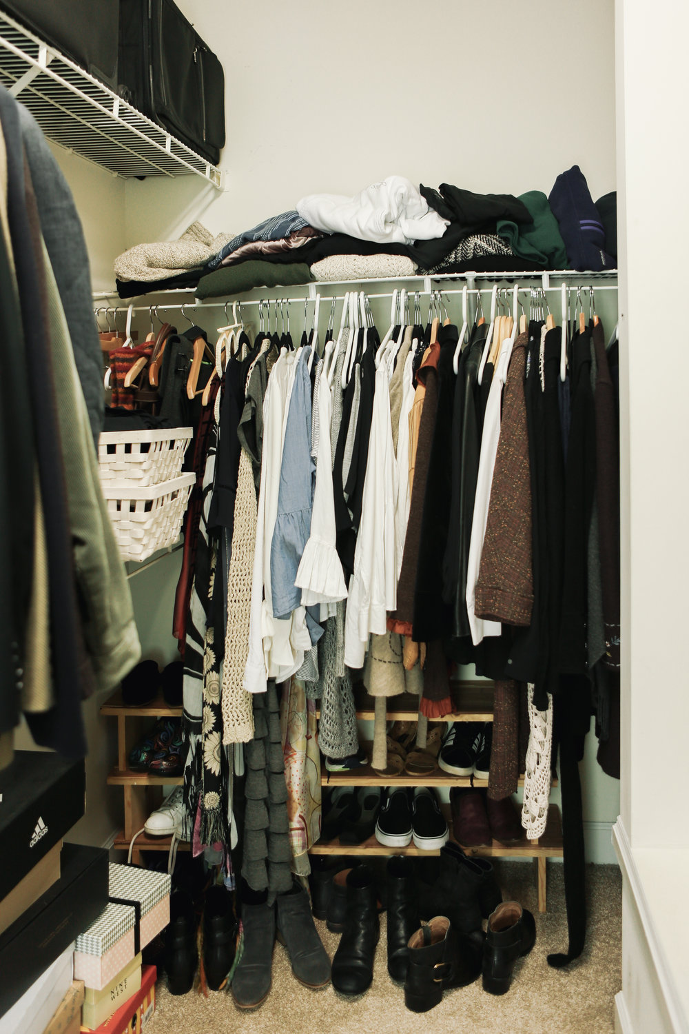 Step 1 - Does your closet look like this?! It's hard to find and put together your favorite summer outfits when all your winter items are mixed in and there is no organizing system in place.First Step - Take ALL fall and winter garments out of your closet. That means sweaters, jackets, accessories (hats, gloves, scarves), winter boots and anything wool and a heavier weight. Most importantly, remove anything that you know you will not wear for the next three months.