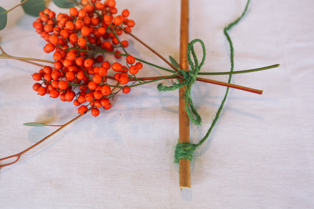 Step 4 - Tie another length of twine to create a way to hang your garland on the wall.