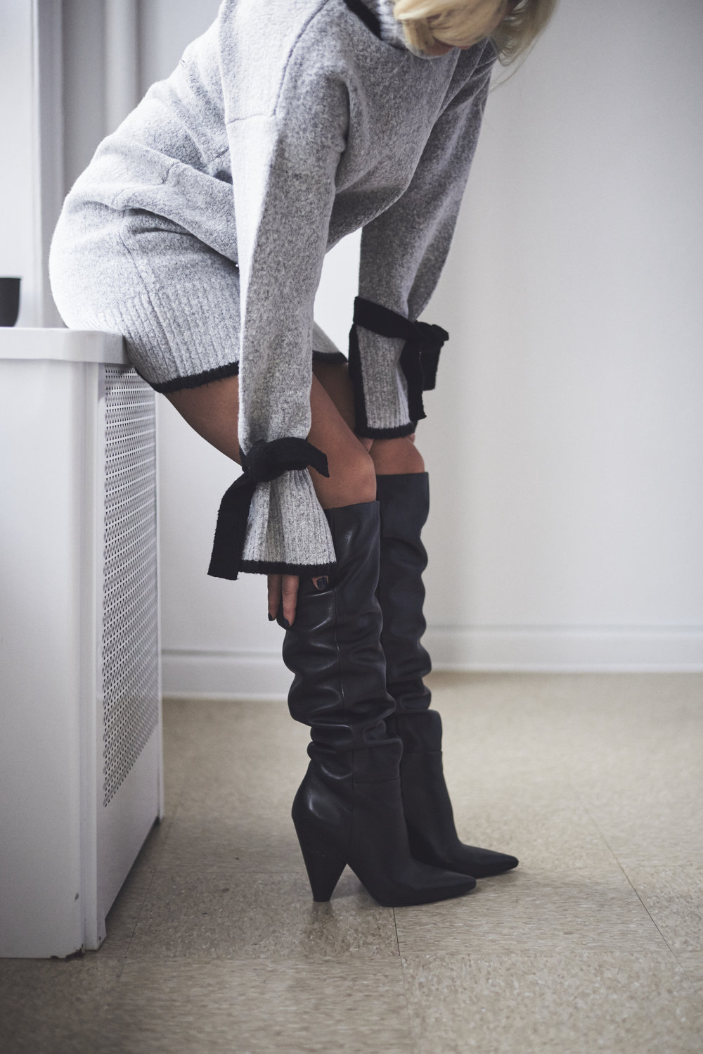 Shop The Best Slouchy Boots to Fit Your Style - The perfect investment for a wear-it-now winter purchase, but a practical transitional boot for the spring.Photo Credit: Emerald Baker
