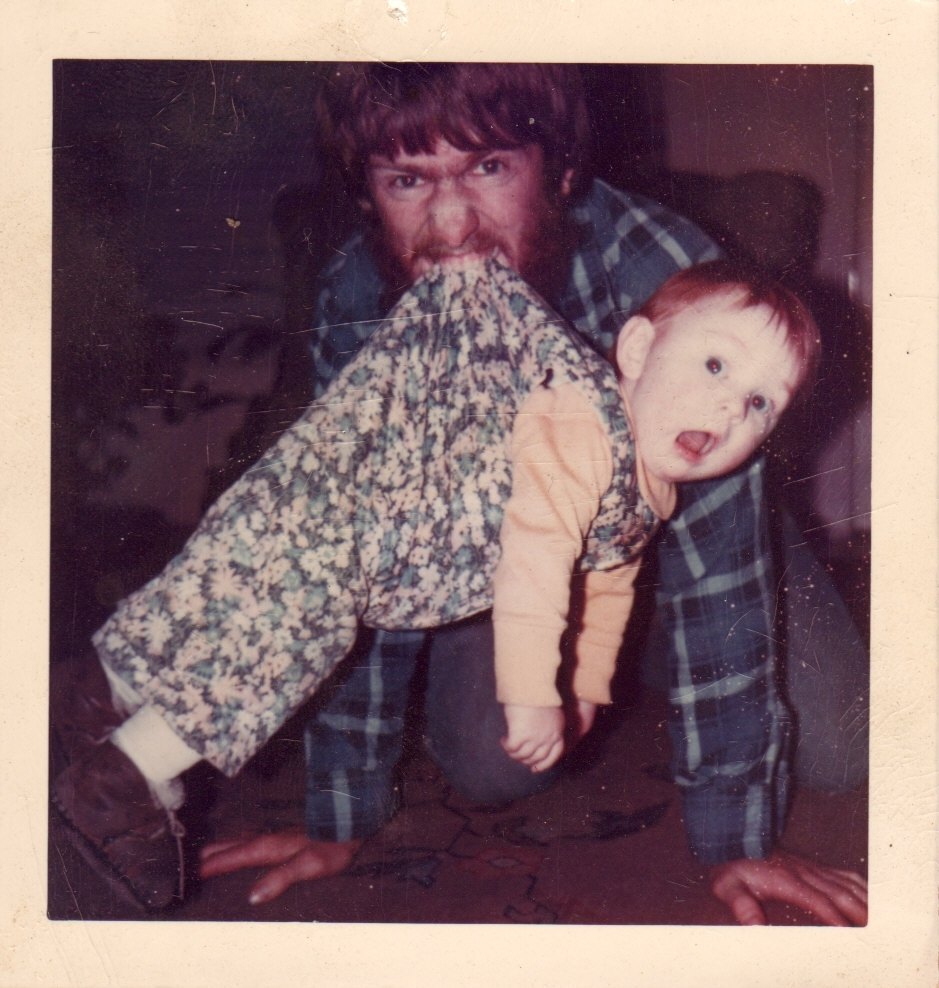 1976 scary Dad with baby Apricot dangling by the back of her overalls (1).jpg
