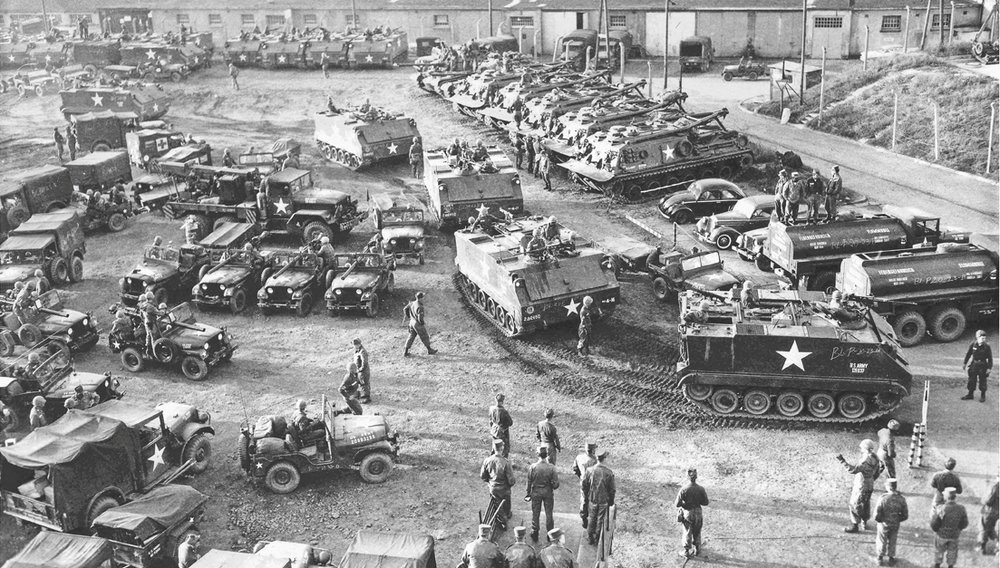 2nd Armored Division troops move out from a   pre-positioned equipment location in Germany.