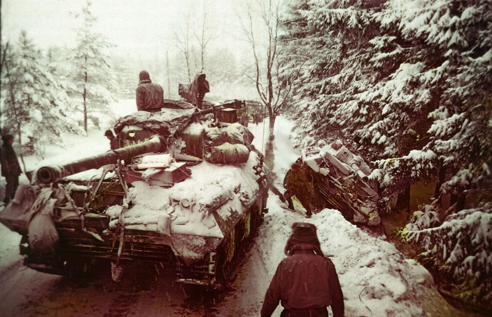 Under radio silence, MG Harmon's division made an epic 113 mile road march on treacherous ice-covered roads to engage German forces during the Battle of the Bulge, ultimately destroying its counterpart - the 2nd Panzer Division.