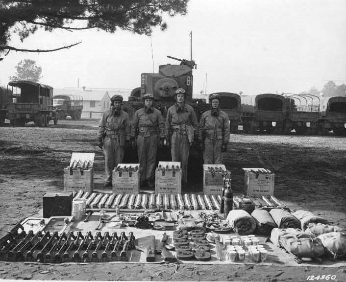 M3 light tank crew and supplies at Fort Benning, Georgia, 18 Dec 1941.