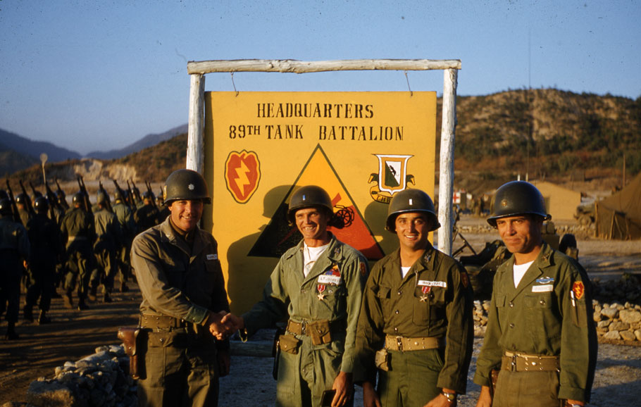 Tanker uniform reference photo. 1st lieutenant (2nd from the left) is from the 89th Tank Battalion. Note that he wears the 89th Tank Battalion armor patch over the heart and the 25th Infantry Division patch on his left shoulder.
